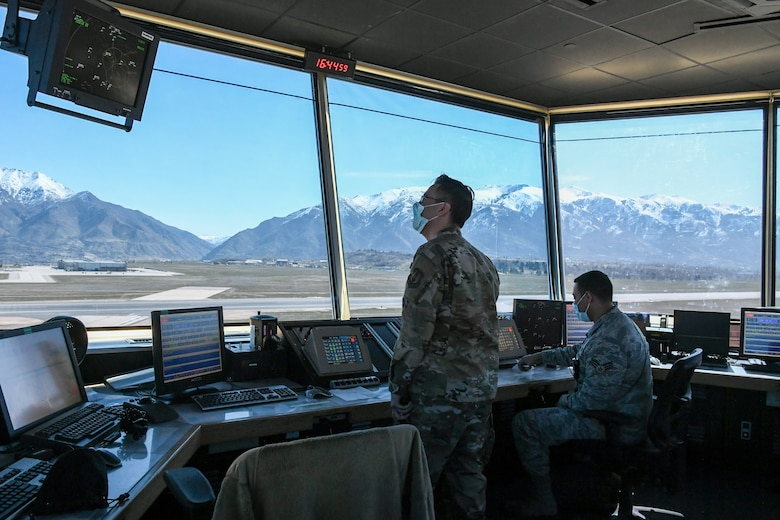Controllers working in the air traffic control tower.