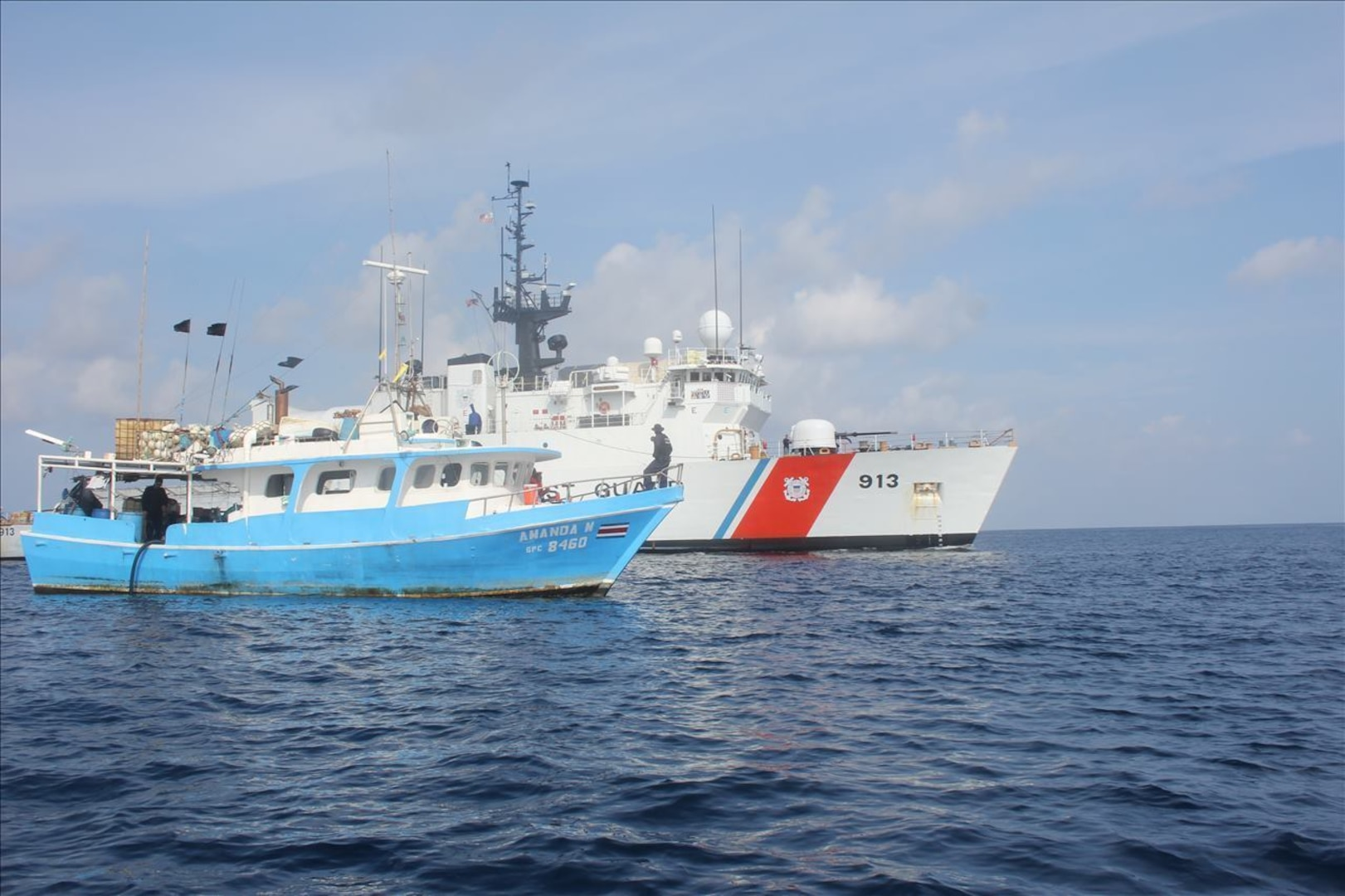 Coast Guard Cutter Mohawk (WMEC-913) members conduct a boarding of the Amanda M fishing vessel in the Eastern Pacific Ocean off the coast of Central America, April 9, 2020. During the boarding, the crew discovered several false compartmen