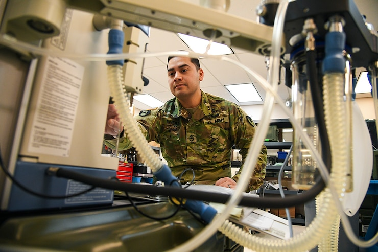 U.S. Army Staff Sgt. Jesus Rivera tests an anesthesia machine for leaks and functionality at the USAMMA MMOD-UT depot, Hill Air Force Base, Utah, Jan. 10, 2018. The unit's biomedical equipment technicians test and validate repaired and new equipment before sending those assets to unit. (U.S. Air Force photo by R. Nial Bradshaw)