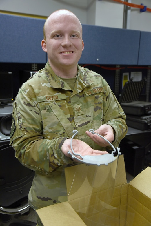 Staff Sgt. Zachary Goyer, with the 552nd Air Control Network Squadron, has been running his personal 3-D printer non-stop for two weeks, making clips to hold plastic face shields for medical workers. His printer makes a new clip about every hour and a half. He's been using overhead transparency sheets or binder covers he's ordered online for the plastic shields. (U.S. Air Force photo/Kelly White)