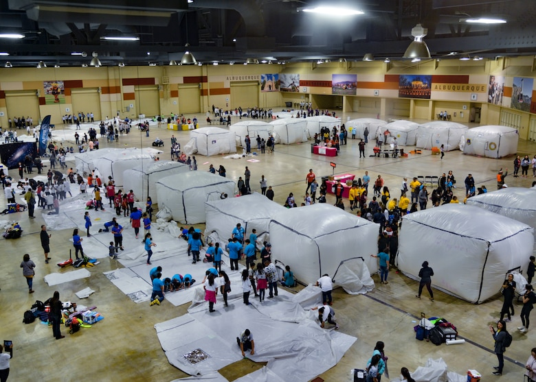 photo of students and inflatable cubes inside a convention center