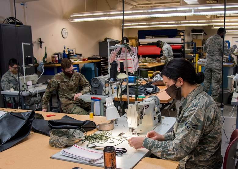 U.S. Air Force Airmen from the 92nd Operation Support Squadron Aircrew Flight Equipment unit create protective facemasks for Airmen at Fairchild Air Force Base, Washington, April 10, 2020. The task of creating protective facemasks may be outside the AFE unit's expertise, however, their broad skill set and technical training enables them to meet this need in support of Airmen and enabling Fairchild's mission success. (U.S. Air Force photo by Senior Airman Jesenia Landaverde)
