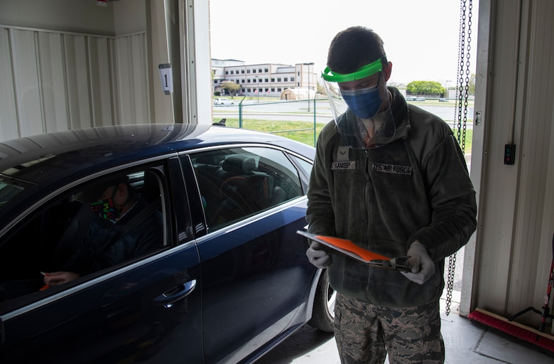 """Airman 1st Class Trent Ramsey, 436th Aerial Port Squadron air transportation cargo processor, completes a medical screening while wearing a 3D printed face shield April 10, 2020 at Dover Air Force Base, Delaware. The face shields were printed by the Dover Air Force Base Innovation Lab """"BEDROCK"""" for use by medical and security forces personnel supporting COVID-19 response efforts.  (U.S. Air Force photo by Airman 1st Class Jonathan Harding)"""