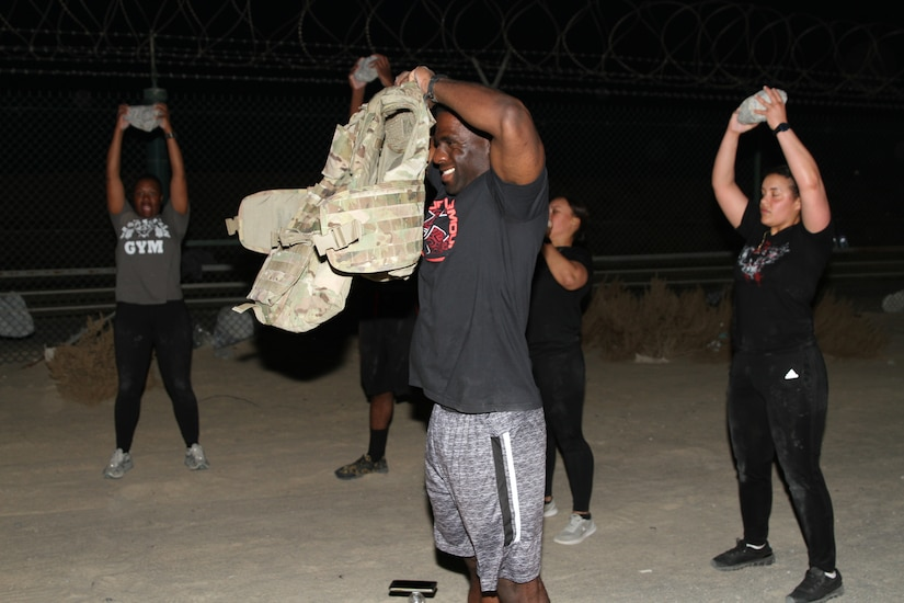 U.S. Army Soldiers assigned to the 42nd Infantry Division conduct physical training on Camp Arifjon, Kuwait, March 26, 2020. Sgt. First Class Johnny Han, an Equal Opportunity representative with the 42nd, led a group of Soldiers to conduct training after hours amid Coronavirus safety persuasions on post. (U.S. Army photo by Sgt. Andrew Valenza)