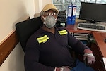 Defense Logistics Agency Energy Quality Assurance Representative Anthony Floyd wears protective gear