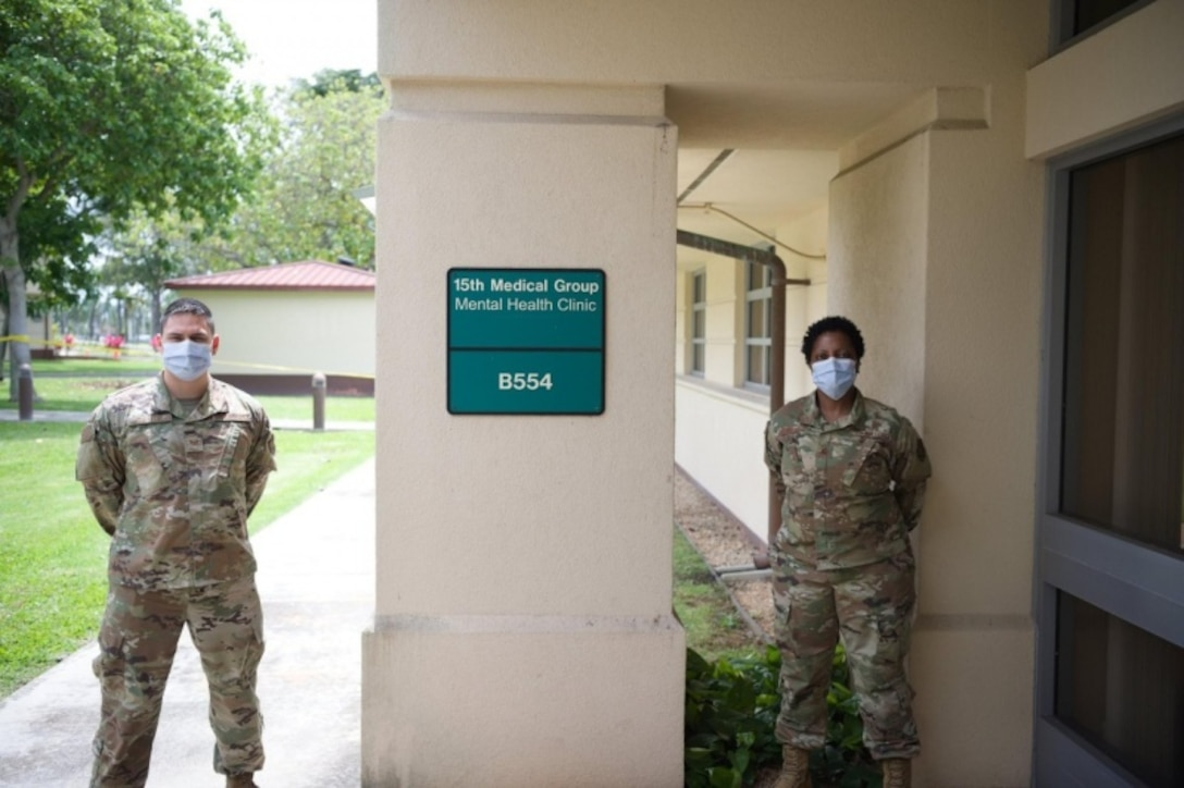 Staff Sgt. Adam Taylor, 15th Medical Operations Squadron mental health technician, with Maj. Tracy Golliday-Corley, 15th MDOS clinical social worker, standby ready to continue assisting Airmen, just in a mostly virtual way due to the COVID-19 pandemic at the 15th Medical Group Mental Health Clinic at Joint Base Pearl Harbor-Hickam, Hawaii, April 10, 2020. The Mental Health Clinic provides Airmen with  tools to overcome mental health challenges. (U.S. Air Force photo by 2nd Lt. Benjamin Aronson)