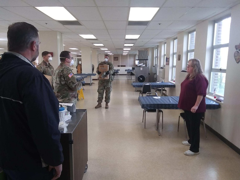 Members of the West Virginia National Guard (WVNG) provide training on proper personal protective equipment (PPE), sanitizing and decontamination methods and best practices for the prevention of COVID-19 spread to staff at the Barboursville Veterans home April 14, 2020. Members of Task Force Chemical, Biological, Radiological and Nuclear (CBRN) Response Enterprise (TF-CRE) will make additional visits to the facility in the coming days to train all support staff and facilitate implementing plans and procedures for how to deal with COVID-19 positive cases, if any were to arrive. (Courtesy photo)