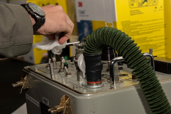 Capt. Clinton Brandt, 9th Bomb Squadron weapon systems operator, sanitizes aircrew flight equipment after using it at Dyess Air Force Base, Texas, April 10, 2020.