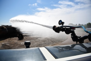 A Striker 1500 shoots out water toward an exercise aircraft model April 10, 2020, on Columbus Air Force Base, Miss. Columbus Air Force Base Fire and Emergency Services is tasked with mitigation and incident management for fire, aircraft, hazardous material, medical and other emergencies. (U.S. Air Force photo by Airman 1st Class Jake Jacobsen)