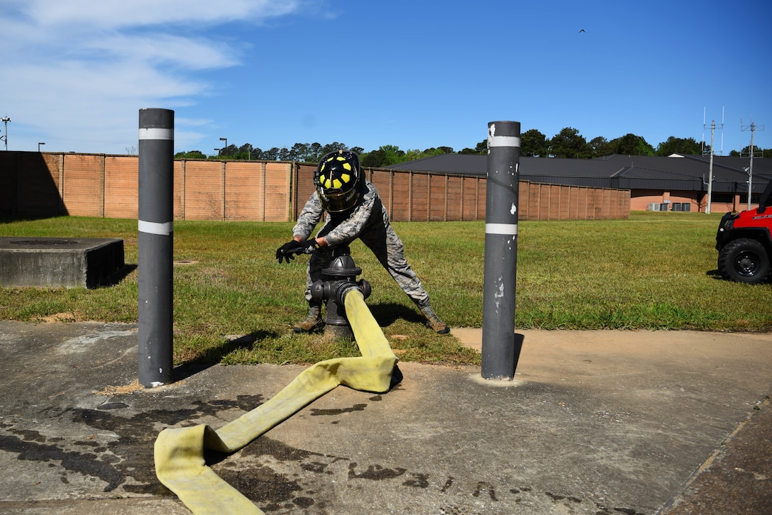 Airman 1st Class Khalil Jeter, 14th Civil Engineer Squadron firefighter, releases water from a fire hydrant April 10, 2020, on Columbus Air Force Base, Miss. A Striker 1500 can hold up to 1,500 gallons of water in them to ensure readiness and the protection of the community in emergency situations. (U.S. Air Force photo by Airman 1st Class Jake Jacobsen)