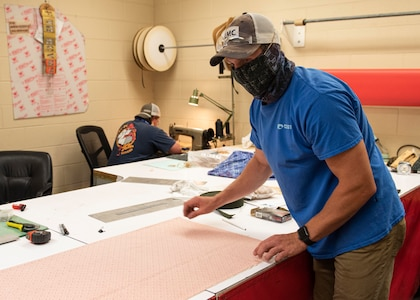 Kenneth Swearingin, left, and Brent Stephens, right, from NSWC PCD's Rigging Shop are sewing non-medical, Food and Drug Administration (FDA) approved design with two layers of 100% cotton fabric and elastic band in support of protecting NSWC PCD employees from COVID-19.
