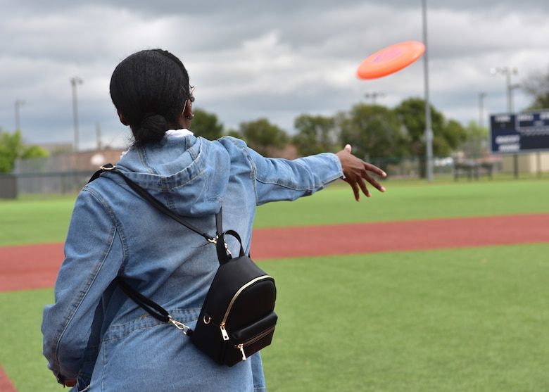 A competitor in the enlisted student category competes in the disc toss event during the 315th Training Squadron 'Break the Pandemic' competition on Goodfellow Air Force Base, Texas, April 11, 2020. The 315th TRS hosted the competition to give members of Team Goodfellow a way to interact while observing social distancing regulations in response to the COVID-19 pandemic. (U.S. Air Force photo by Staff Sgt. Chad Warren)
