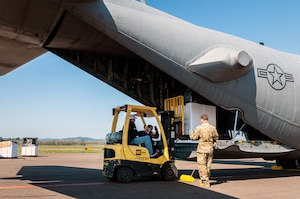 Cargo being loaded onto aircraft.
