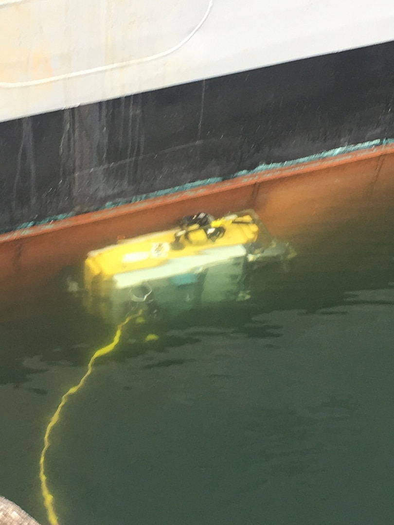 Seaward Marine Services' proprietary Lamp Ray Remotely-Operated Vehicle crawling along the immersed hull of Naval Surface Warfare Center, Port Hueneme Division's Self Defense Test Ship in March in San Diego.