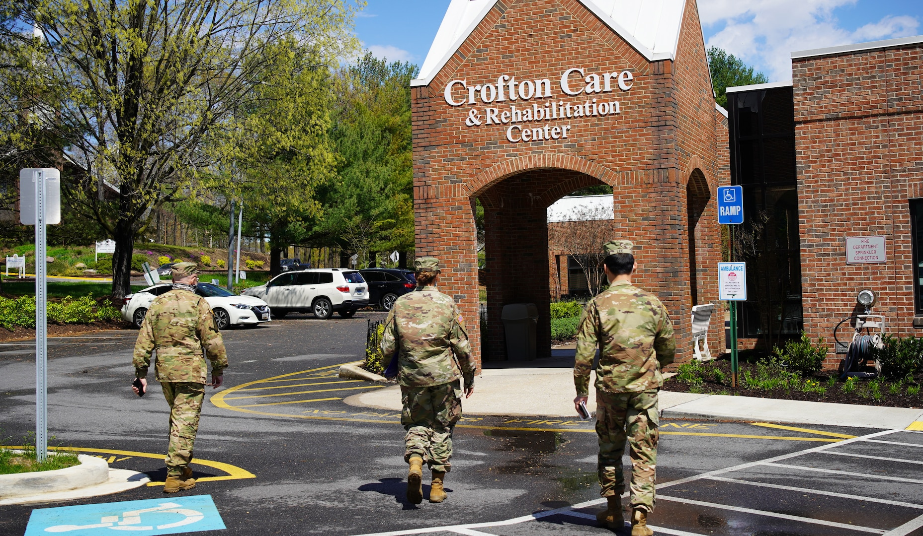 Maryland National Guard members led by Col. Eric Allely, Maryland State Surgeon, arrive at Crofton Care & Rehabilitation Center in Crofton, Maryland, April 9, 2020, to evaluate measures to protect against the spread of COVID-19.
