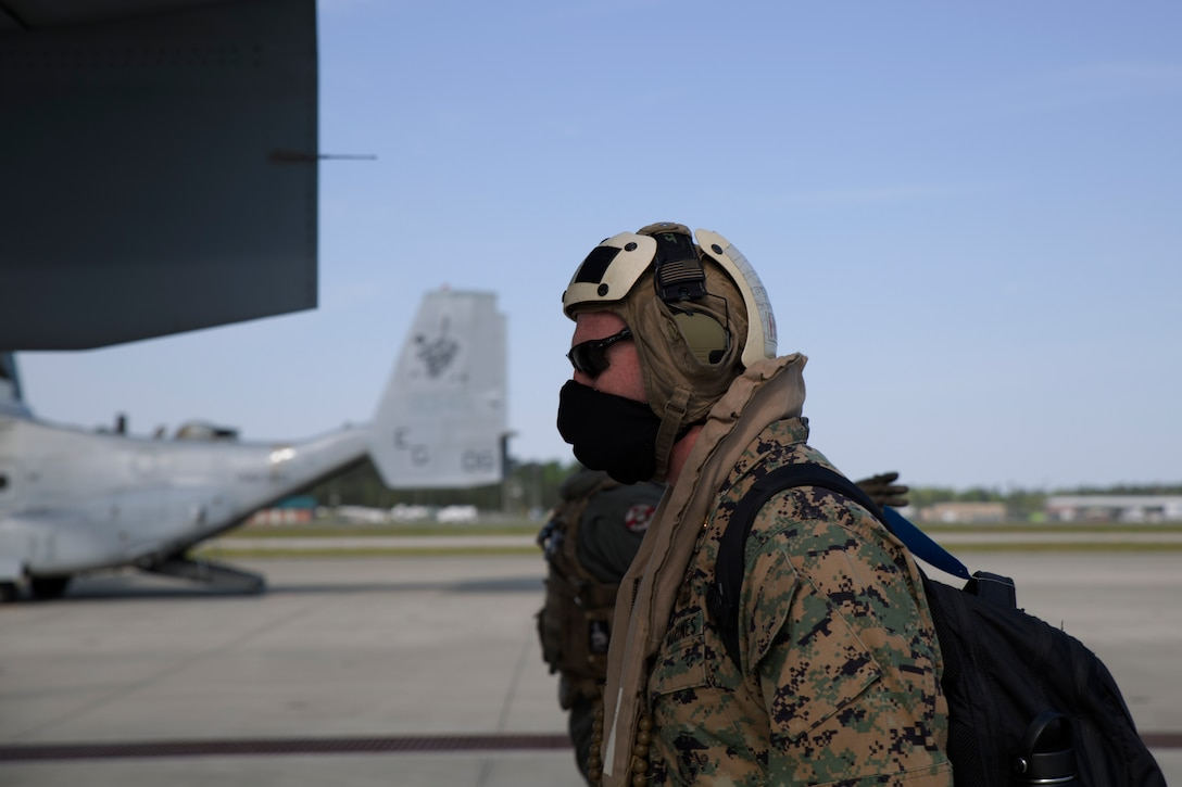 A U.S. Marine boards an MV-22B Osprey as they prepare for takeoff from the flight line at Marine Corps Air Station New River, N.C., April 10.