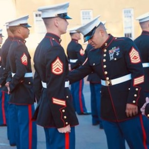 Students are inspected to ensure proper fit of their Dress Blues