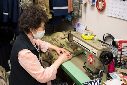 Kum Sun Yun, the manager of Stripes Alterations Shop, sews a uniform top at Joint Base Charleston, S.C., April 7, 2020. Employees at Stripes Alterations Shop are taking safety precautions such as wearing masks, cleaning work areas and washing their hands frequently. The hours of operation for alterations are from 9 a.m. to 5 p.m. Monday through Friday and 9 a.m. to 3 p.m. on Saturdays.