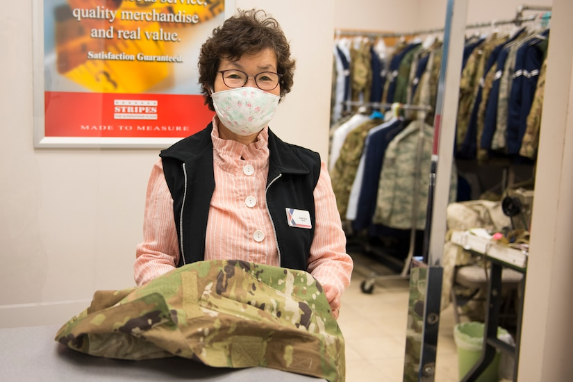 Kum Sun Yun, the manager of Stripes Alterations Shop, poses for a photo at Joint Base Charleston, S.C., April 7, 2020. Employees at Stripes Alterations Shop are taking safety precautions such as wearing masks, cleaning work areas and washing their hands frequently. The hours of operation for alterations are from 9 a.m. to 5 p.m. Monday through Friday and 9 a.m. to 3 p.m. on Saturdays.