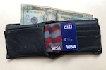 A wallet with cash and credit cards.