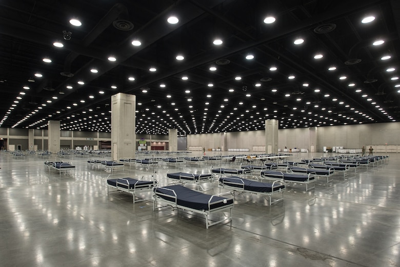 More than 30 members of the Kentucky Air National Guard's 123rd Civil Engineer Squadron set up hospital beds and clinical space at the Kentucky Fair and Exposition Center in Louisville, Ky., April 13, 2020. The site, which is expected to be operational April 15, will serve as an Alternate Care Facility for patients suffering from COVID-19 if area hospitals exceed available capacity. The location initially can treat up to 288 patients and is scalable to 2,000 beds. (U.S. Air National Guard photo by Dale Greer)
