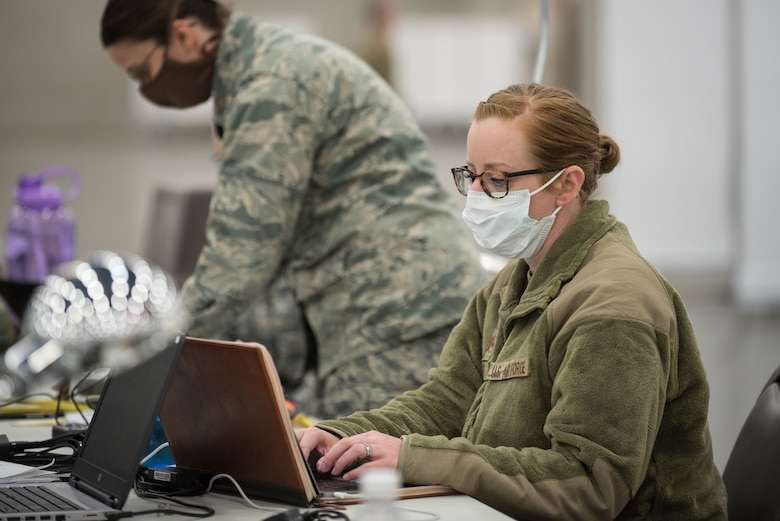 Maj. Amy Riley of the Kentucky Air National Guard's 123rd Medical Group Detachment 1 prepares staff schedules for an Alternate Care Facility at the Kentucky Fair and Exposition Center in Louisville, Ky., April 14, 2020. The site, which is expected to be operational April 15, will serve patients suffering from COVID-19 if area hospitals exceed available capacity. The facility initially will offer care for up to 288 patients and is scalable to 2,000 beds. (U.S. Air National Guard photo by Dale Greer)
