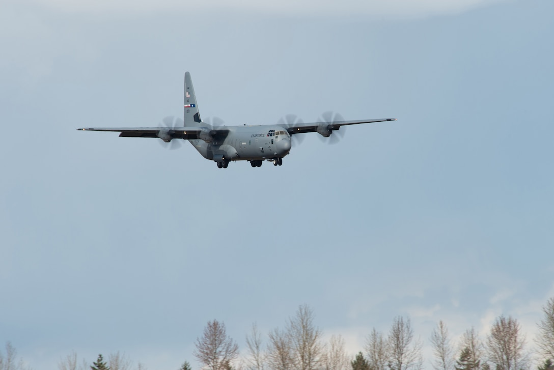 A U.S. Air Force C-130J Super Hercules approaches the runway at Joint Base Lewis-McChord, Wash., March 25, 2020. The C-130 carried U.S. Army Soldiers assigned to the 627th Hospital Center, Fort Carson, Colo., and equipment to set up a field hospital in Seattle, Wash. to help decompress bed space at local hospitals to enable them to treat patients infected with COVID-19. (U.S. Air Force photo by Senior Airman Tryphena Mayhugh)