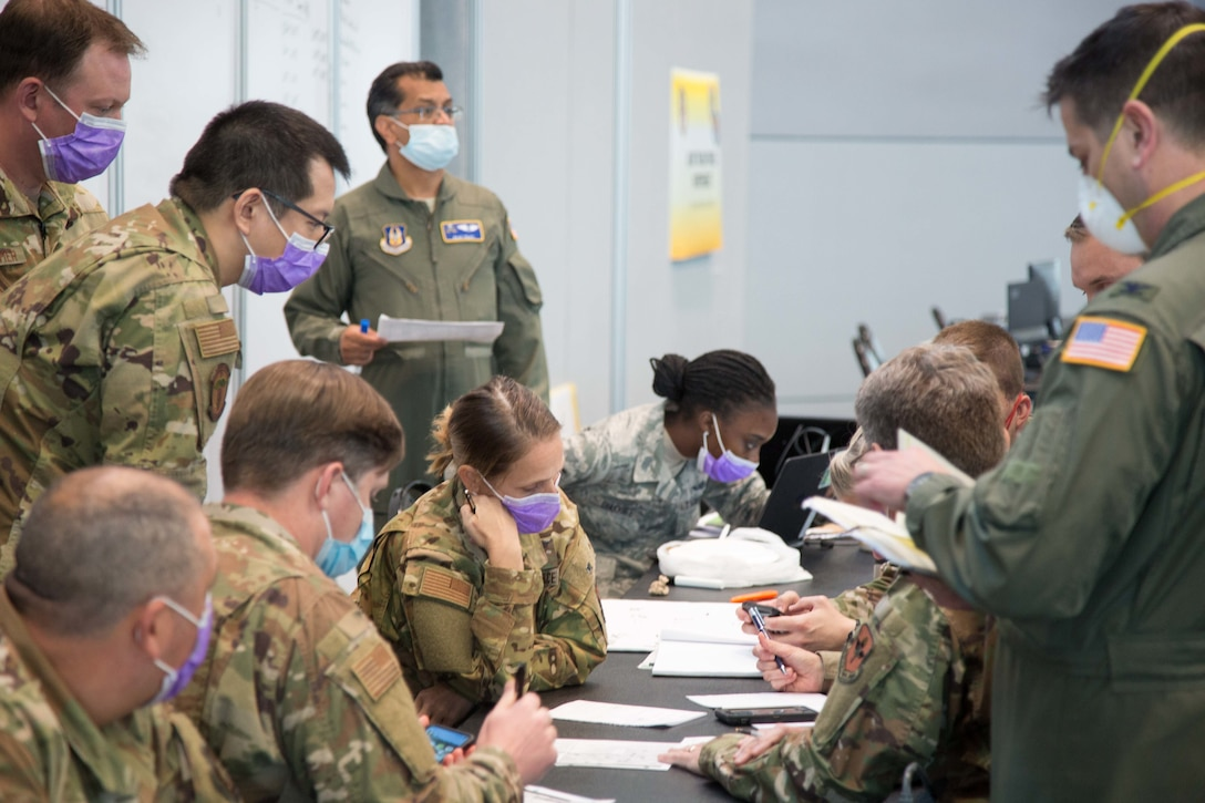 U.S. Air Force medical providers, assigned to the Javits New York Medical Station (JNYMS), discuss task force personnel capability to augment local hospitals as part of the COVID-19 response effort, April 7, 2020. The 621st Mobility Support Operations Squadron AMLOs provided airlift support to U.S. Army North to move soldiers into field hospital units in COVID-19 hotspots. (U.S. Army Photo by Sgt. Deonte Rowell)