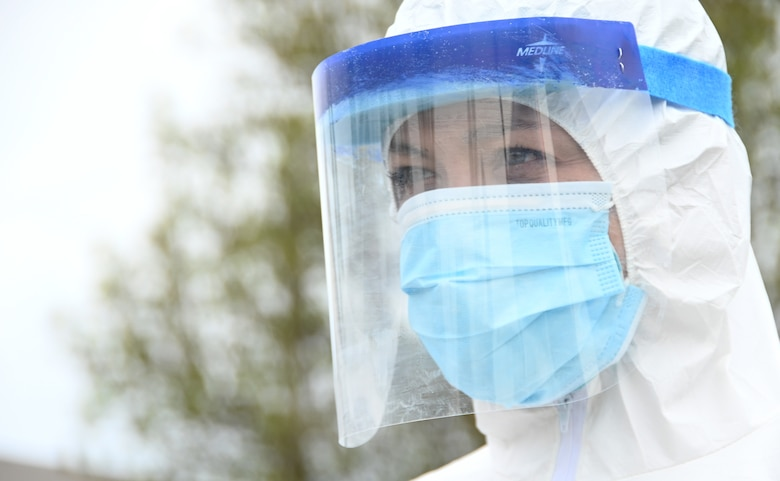 U.S. Air Force Tech. Sgt. Leigh Crane, an aerospace medical technician with the 118th Medical Group, Tennessee Air National Guard, waits for a patient to arrive at a drive-up COVID-19 testing site March 30, 2020 in Livingston, Tennessee. (U.S. Air National Guard photo by Master Sgt. Jeremy Cornelius).