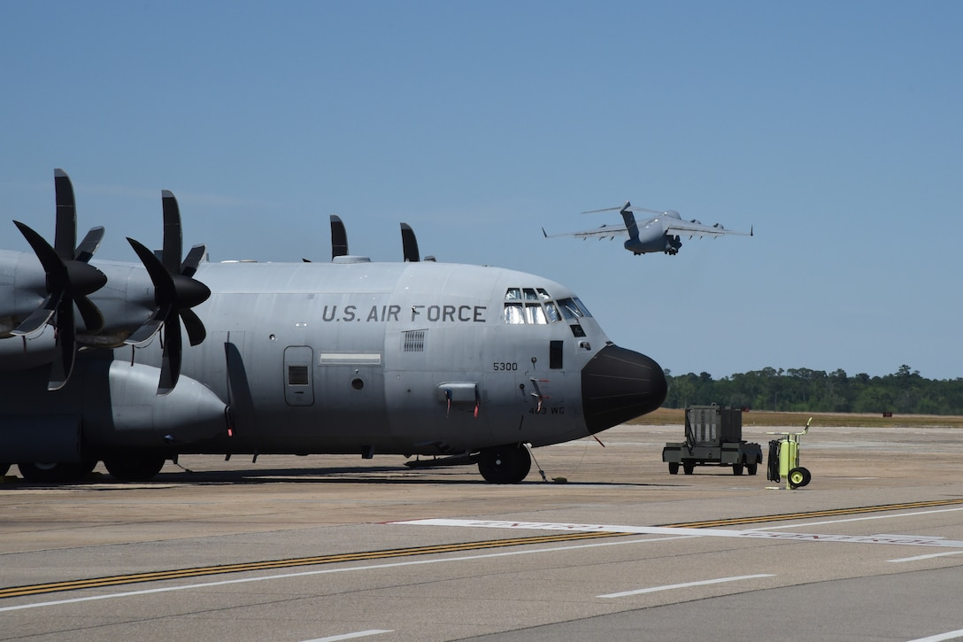 A C-17 Globemaster III flown by the 89th Airlift Squadron, based out of Wright-Patterson Air Force Base, Ohio, departs Keesler AFB, Miss., April 15, 2020. Approximately 10 Airmen with the 403rd Wing's 36th Aeromedical Evacuation Squadron mobilized to support COVID-19 relief efforts. These reservists will provide life-saving in-flight patient care. (U.S. Air Force photo by Lt. Col. Marnee A.C. Losurdo)
