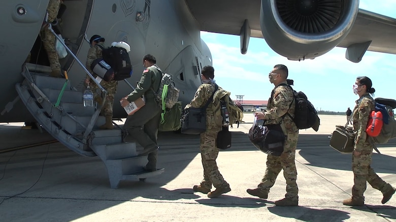 Medical personnel with the 433rd Aeromedical Evacuation Squadron board a C-17 Globemaster III April 15, 2020 at Joint Base San Antonio-Lackland, Texas.