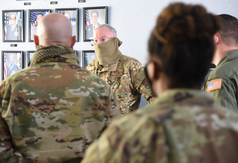 Col. Jeffrey A. Van Dootingh, 403rd Wing commander, addresses approximately 10 Airmen with the 403rd Wing's 36th Aeromedical Evacuation Squadron prior to their departure April 15, 2020. The Reserve Citizen Airmen were mobilized to support COVID-19 relief efforts. These reservists will provide life-saving in-flight patient care. (U.S. Air Force photo by Lt. Col. Marnee A.C. Losurdo)
