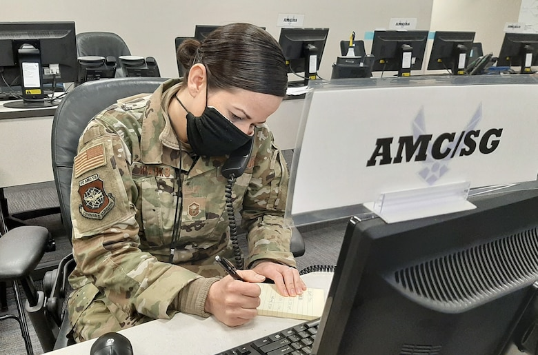 Master Sgt. Melissa Sparks, Air Mobility Command Commander's Battle Staff SG or medical representative, coordinates daily operations from the CBS in support of the fight against the COVID-19 pandemic at Scott Air Force Base, Illinois, April 15, 2020. Since its activation March 4, 2020, the AMC CBS has served as a single, 24/7 cell of experts to ensure uninterrupted rapid global mobility amidst the COVID-19 pandemic, producing more than 40 Battle Staff Directives to guide Airmen on everything from aircraft decontamination to patient movement to timely reporting of COVID-19 cases at AMC installations. (U.S. Air Force photo by Col. Damien Pickart)