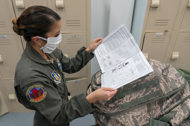 Senior Airman Emilie Canlas, 36th Aeromedical Evacuation Squadron aeromedical evacuation technician, reads over her checklist of assigned equipment April 9, 2020 at Keesler Air Force Base, Miss. The call for aeromedical support came just days after the Air Force Reserve mobilized more than 120 medical personnel across the nation to Joint Base McGuire-Dix-Lakehurst, New Jersey, to help with the fight against COVID-19 in New York City. The specific mission details of the aeromedical evacuation teams mobilizing today are still in coordination, but these Air Force Reservists can provide critical patient care at any location worldwide. (U.S. Air Force photo by Tech. Sgt. Christopher Carranza)