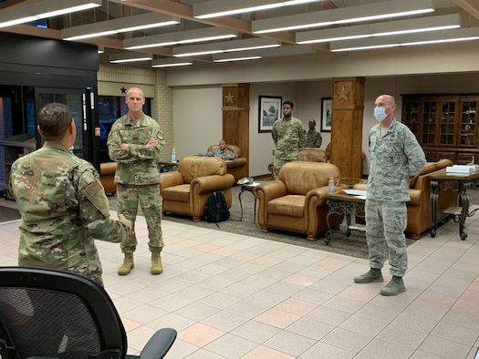 U.S. Air Force Col. Steven Anderson, 688th Cyberspace Wing commander, Chief Master Sgt. Israel Jaeger, 688th Cyberspace Wing Command Chief, Capt. Nathan Spradley, 502nd Air Base Wing, Master Sgt. Stephanie Russ, 323rd Training Squadron, and Staff Sgt. Ryan Owen, 67th Operations Support Squadron, volunteer for charge of quarters duty in support of Basic Military Training Airmen overnight Tuesday, April 7, 2020, Joint Base San Antonio – Lackland, Texas. CQ duties include intake, tracking and reporting, wellness checks, meal and personal item delivery, and arranging transport upon release. (U.S. Air Force photo by Chief Master Sgt. Israel Jaeger)