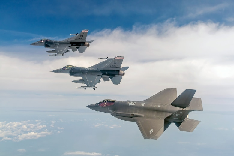 F-16 Fighting Falcons fly with F-35 Lightning II