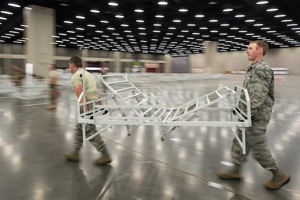 More than 30 members of the Kentucky Air National Guard's 123rd Civil Engineer Squadron set up hospital beds and clinical space at the Kentucky Fair and Exposition Center in Louisville, Ky., April 11, 2020. The site, which is expected to be operational April 15, will serve as an Alternate Care Facility for patients suffering from COVID-19 if area hospitals exceed available capacity. The location initially can treat up to 288 patients and is scalable to 2,000 beds. (U.S. Air National Guard photo by Dale Greer)