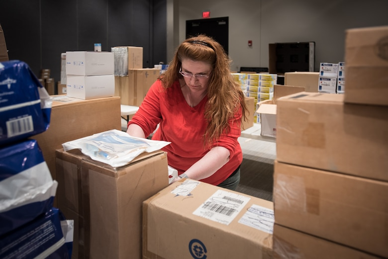 Margaret Hibbs, a regional preparedness coordinator for the Kentucky Department of Public Health, sorts medical supplies at the Kentucky Fair and Exposition Center in Louisville, Ky., April 11, 2020. The site will serve as an Alternate Care Facility for patients suffering from COVID-19 if area hospitals exceed available capacity. The location initially can treat up to 288 patients and is scalable to 2,000 beds. (U.S. Air National Guard photo by Dale Greer)