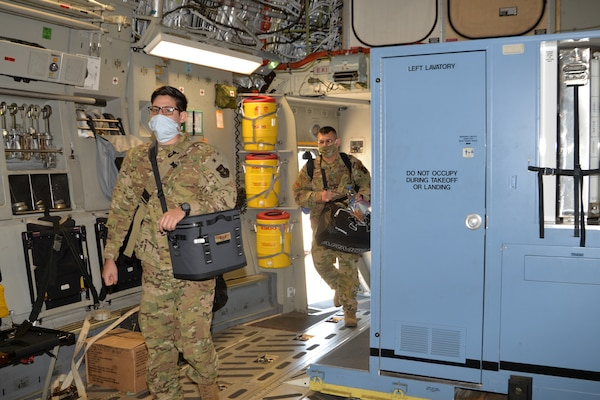 Personnel with the 433rd Aeromedical Evacuation Squadron board a C-17 Globemaster III April 15, 2020 at Joint Base San Antonio-Lackland, Texas.