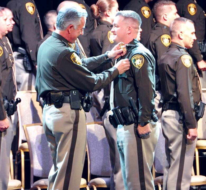 Senior Airman Brett Clashman (right), 926th Wing public affairs specialist, during his academy graduation ceremony for the Las Vegas Metropolitan Police Department. Clashman has been a commissioned peace officer with the Las Vegas Metropolitan Police Department since 2015. In his current role as an intelligence officer, he observes and analyzes crime trends, allowing him to utilize that information to help better direct resources and manpower.