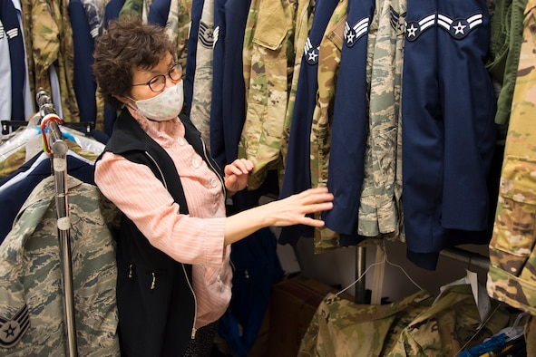 Kum Sun Yun, the manager of Stripes Alterations Shop, sorts through uniforms at Joint Base Charleston, S.C., April 7, 2020. Employees at Stripes Alterations Shop are taking safety precautions such as wearing masks, cleaning work areas and washing their hands frequently. The hours of operation for alterations are from 9 a.m. to 5 p.m. Monday through Friday and 9 a.m. to 3 p.m. on Saturdays.