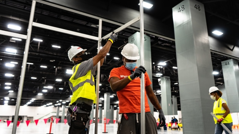 The Miami Beach Convention Center is now a 24 hour construction site crews work at a steady pace to install ICU and Acute Care pods. USACE staff awarded a construction contract Monday April 6, 2020 for $22.5 Million to Robins & Morton of Miami, Fla. to convert the Miami Beach Convention Center into a 450-bed alternate care facility.