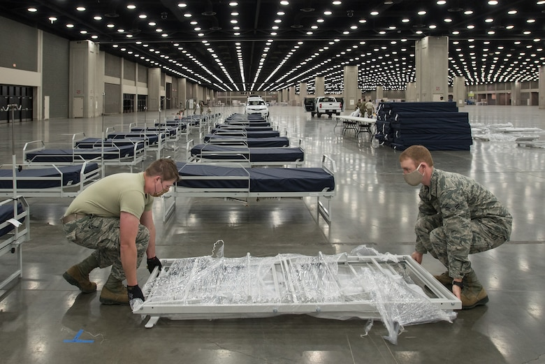 More than 30 members of the Kentucky Air National Guard's 123rd Civil Engineer Squadron set up hospital beds and clinical space at the Kentucky Fair and Exposition Center in Louisville, Kentucky, April 13, 2020. The site, which became operational around April 15, serves as an Alternate Care Facility for patients suffering from COVID-19 if area hospitals exceed available capacity. The location initially can treat up to 288 patients and is scalable to 2,000 beds. (U.S. Air National Guard photo by Dale Greer)