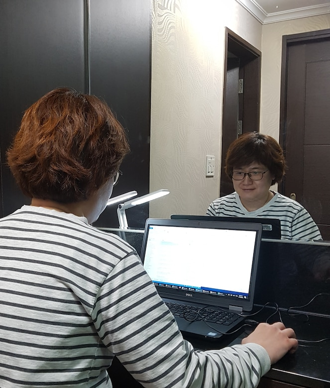 Hur, Myo Boon, U.S. Army Corps of Engineers, Far East District architectural section chief, conducts work at her home during the district telework schedule in response to preventing the spread of COVID 19, Apr. 15.