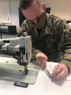U.S. Air Force Staff Sgt. Jacob Wade, 52nd Operations Support Squadron NCOIC of aircrew flight equipment main shop, sews face masks at Spangdahlem Air Base, Germany, April 13, 2020. Wade and U.S. Air Force Tech Sgt. Kevin Robinson, both 52nd OSS members, try to use their time to complete as many face masks as possible. The 52nd Fighter Wing is doing everything possible to help minimize the spread of COVID-19 and is committed to limiting the spread in both the on and off-base community. (52nd Operations Support Squadron courtesy photo)