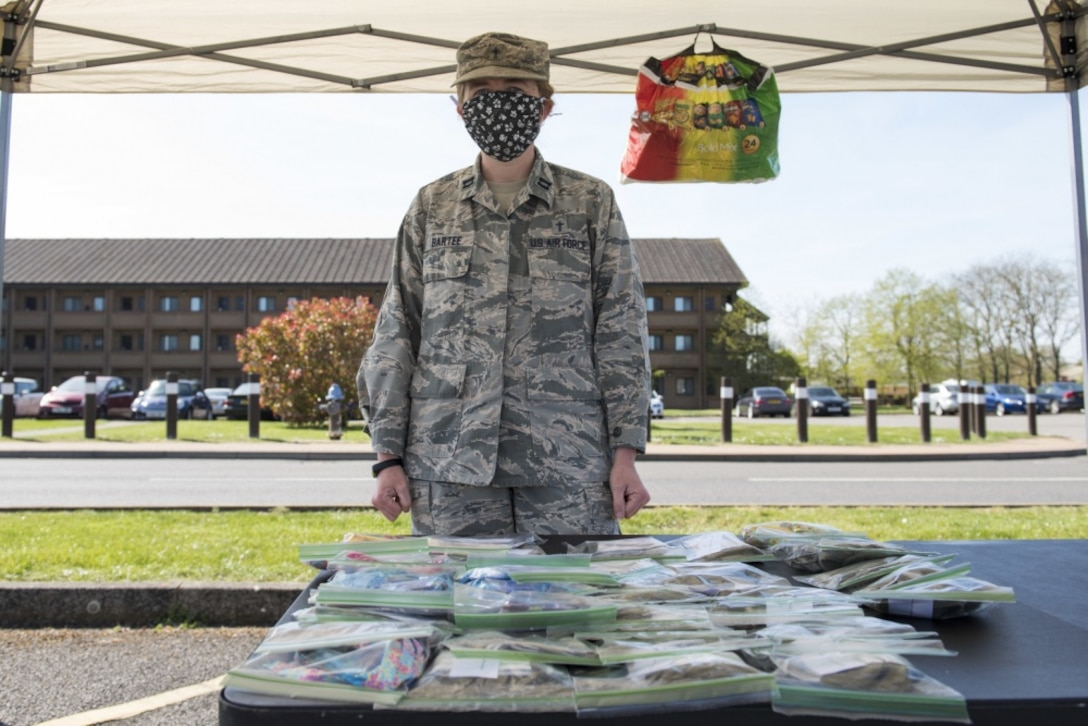 U.S. Air Force Captain Amy Bartee, 501 CSW chaplain, volunteers at a face mask giveaway at RAF Alconbury, England, April 15, 2020. Volunteers made 232 cloth face masks, which were given to community members to prevent the spread of COVID-19. (U.S. Air Force photo by Airman 1st Class Jennifer Zima)