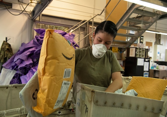 When packages arrive via a mail truck, post office employees must sort through, stock, and prepare the mail for pickup.