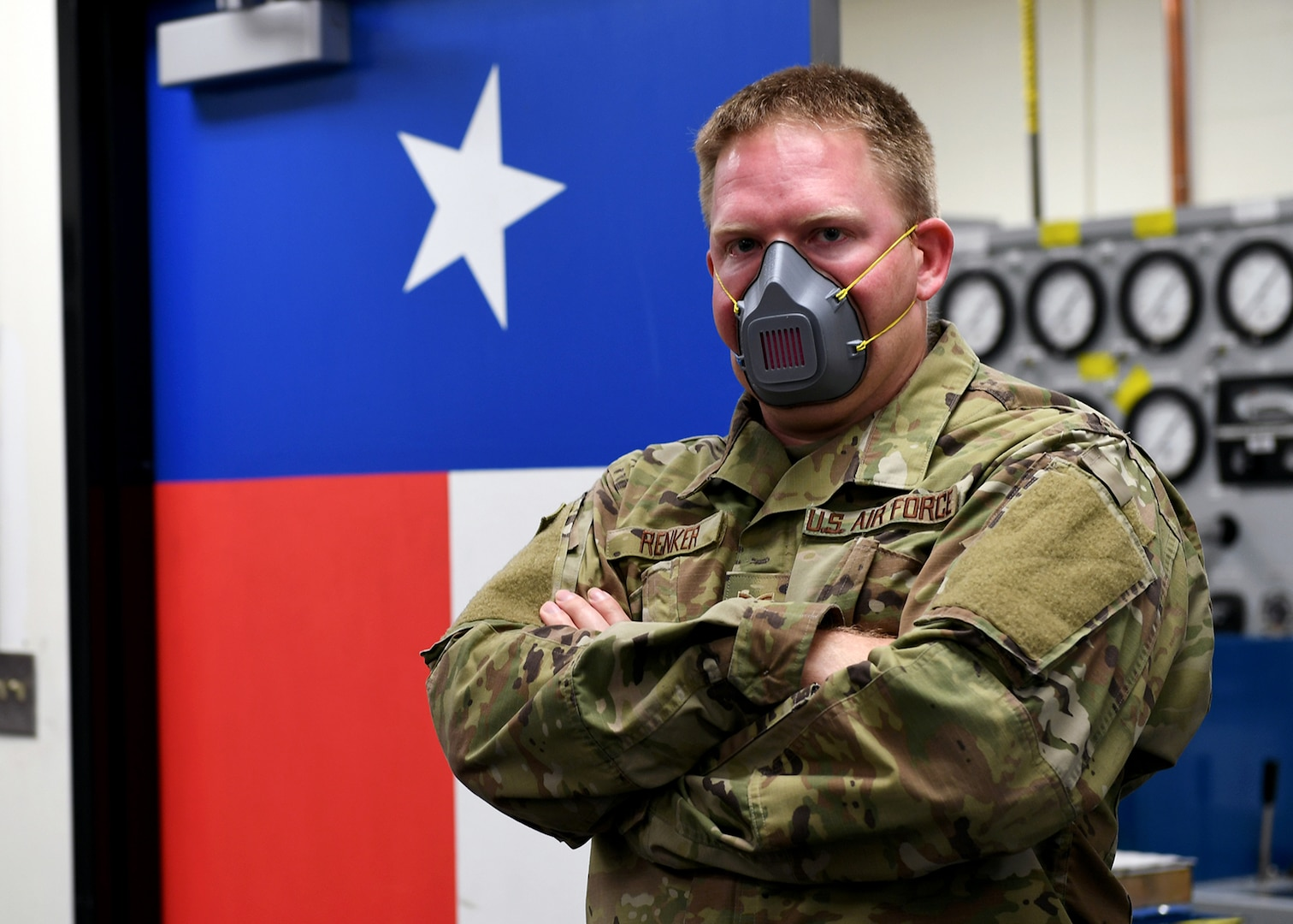 Staff Sgt. Paul Renker, 149th Maintenance Squadron hydraulics technician, wears a mask he made on his personal 3D printer for people in his unit who might need one after initial guidance came out about use and wear for Air Force personnel.