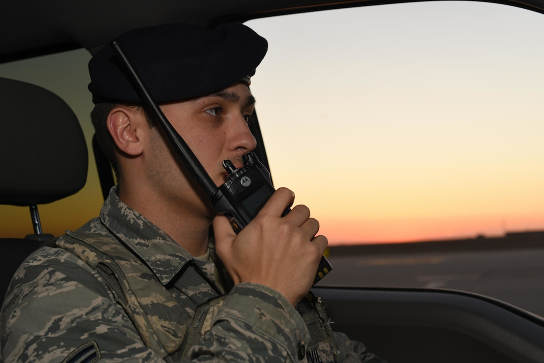Airman 1st Class Tayler Sonnevil, 22nd Security Forces Squadron patrolman, radios into the SFS control center March 24, 2020, at McConnell Air Force Base, Kansas. Flight line security measures require Defenders to challenge personnel within restricted areas to validate their authorization. (U.S. Air Force photo by Senior Airman Alexi Bosarge)