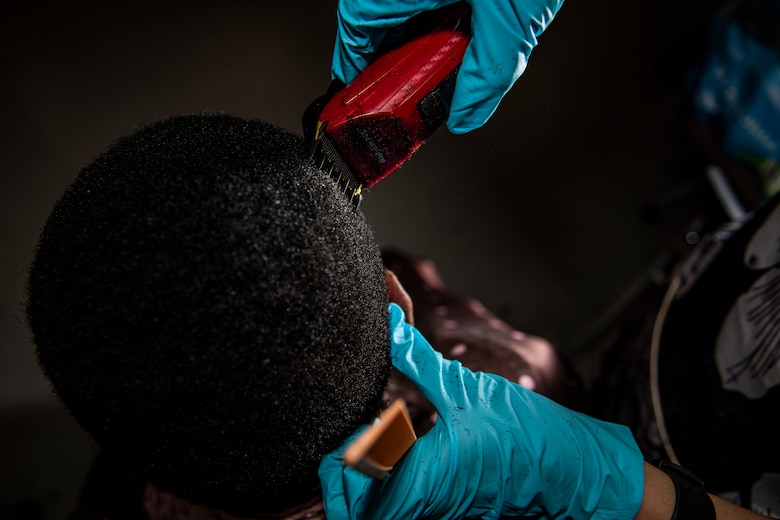 enior Airman Sara Gutherie, 911th Aircraft Maintenance Squadron instruments and controls technician, cuts a fellow Airman's hair at the Pittsburgh International Airport Air Reserve Station, Pennsylvania, April 9, 2020.